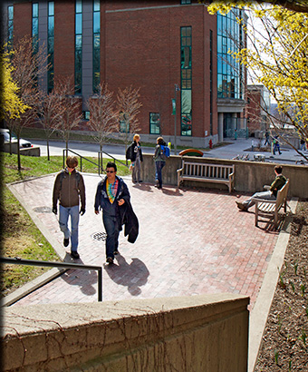 2  students walking on campus