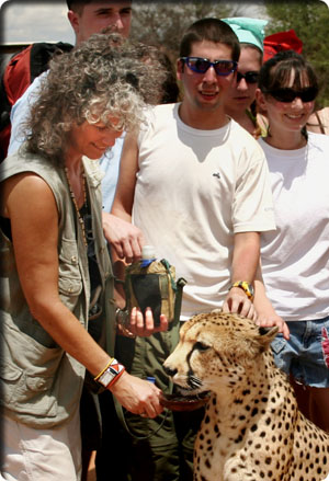 Image of Dr. Laurie Marker and Dr. J. Scott Turner with a cheetah