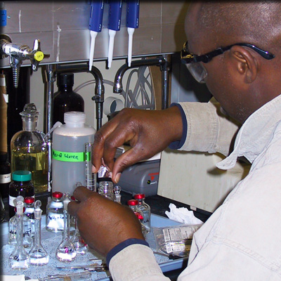 A biochemist works on his experiment