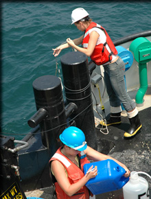 scientists on boat deck