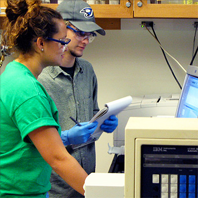 Two students record the results of their experiment