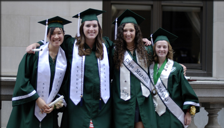 four girls are excited to graduate