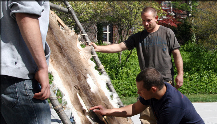 Scraping fur to prepare leather