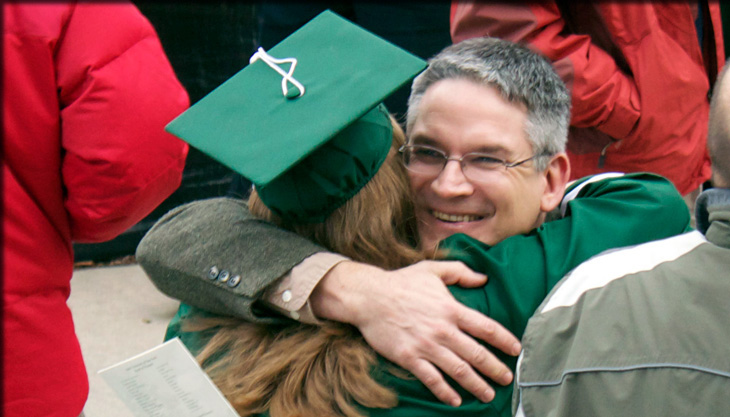graduating student hugging Dr. McGee