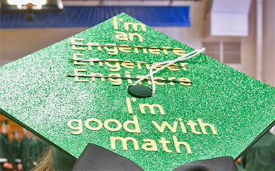 mortarboard with 3  misspellings of engineer crossed out, and the punchline, I'm good at math