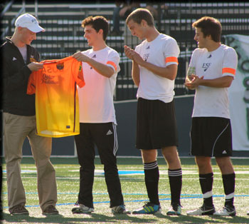 ESF student Kevan Busa, left, was named an honorary captain of the Mighty Oaks soccer team when his former teammates played for the Barkeater Cup.