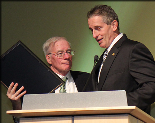 Neil Murphy receiving a proclamation from the governor from Lt. Gov. Robert J. Duffy