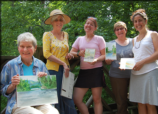 Participants in a watercolor workshop join ESF