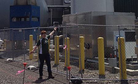 Autumn Elniski strikes a pose in front of the effluent treatment plant at Norampac.