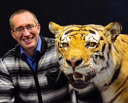 Mikhail Paltsyn poses with taxidermied Amur tiger specimen. Photo: Wendy O. Osborne, ESF