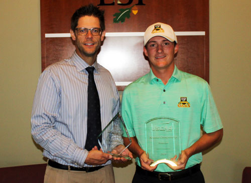 Golf Head Coach John Turbeville (left) and Sean Barron