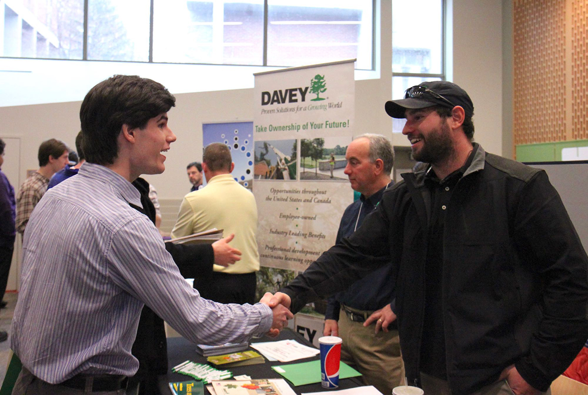 Students and employers meet and network during a past Career Fair. This year
