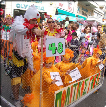 Picture showing a float with people dressed as chickens in regards to the Avian Flu