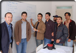 Cyprus students examining equations on the white board