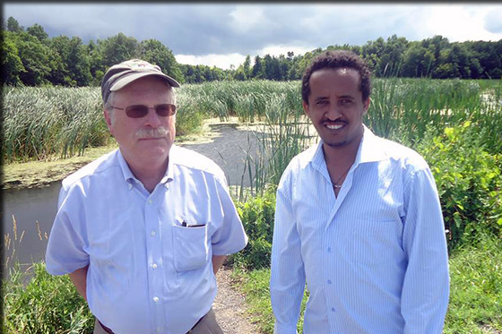 Professors in front of wetland