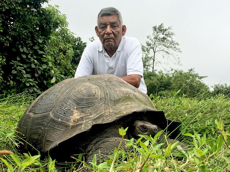 Man with tortoise