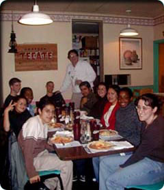 students dining with professor hall